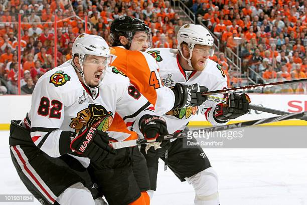 Daniel Briere of the Philadelphia Flyers is pinched by Marian Hossa and Tomas Kopecky of the Chicago Blackhawks during the first period of Game Six...
