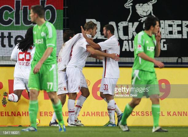 Daniel Brinkmann and Sascha Moelders of Augsburg celebrate Brinkmann's first goal during the Bundesliga match between FC Augsburg and VfL Wolfsburg...