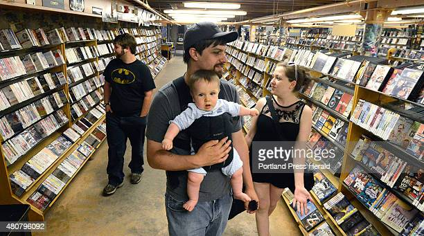 Daniel Brookes and Fiona Harrington of Westbrook peruse videos with their sevenmonthold son Max HarringtonBrookes at Videoport Wednesday July 15 2015...