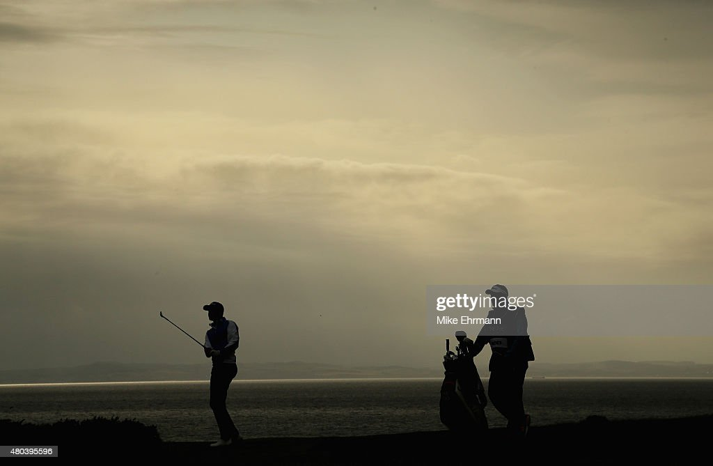 Daniel Brooks of England hits a shot on the 15th hole as his caddie looks on during the third round of the Aberdeen Asset Management Scottish Open at...