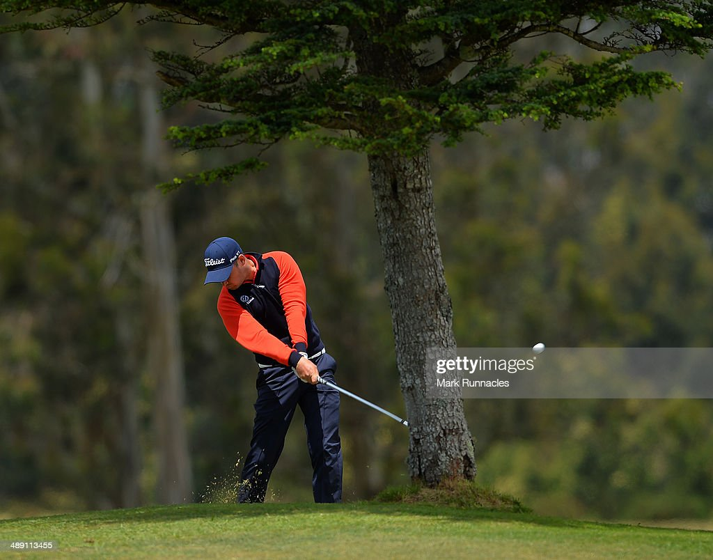 Daniel Brooks of England playing his approach shot to the 3rd green from behind a tree during the Madeira Islands Open - Portugal - BPI at Club de Golf do Santo da Serra on May 10, 2014 in Funchal, Madeira, Port gal.