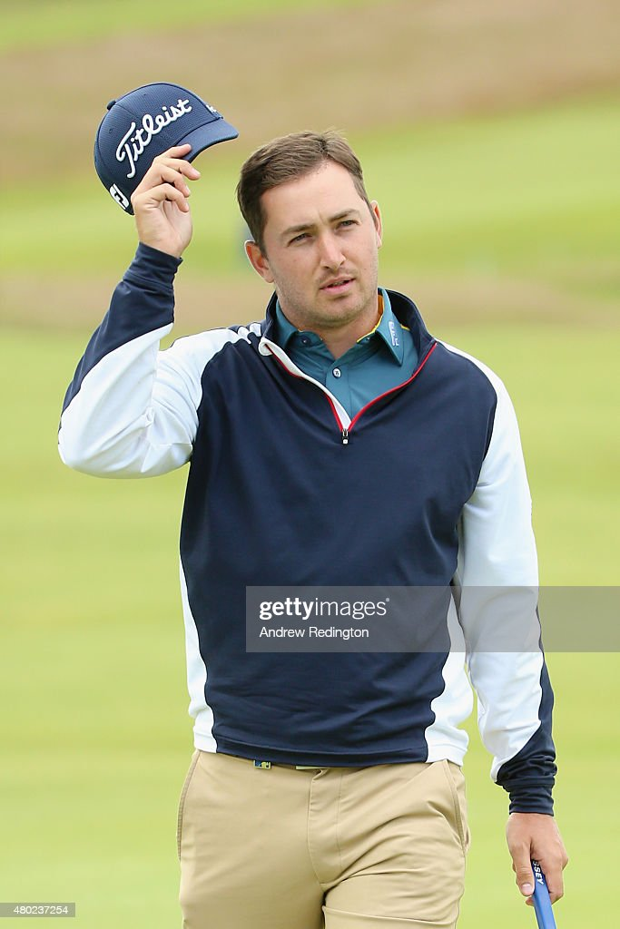 Daniel Brooks of England tips his hat on the 18th green during the second round of the Aberdeen Asset Management Scottish Open at Gullane Golf Club...