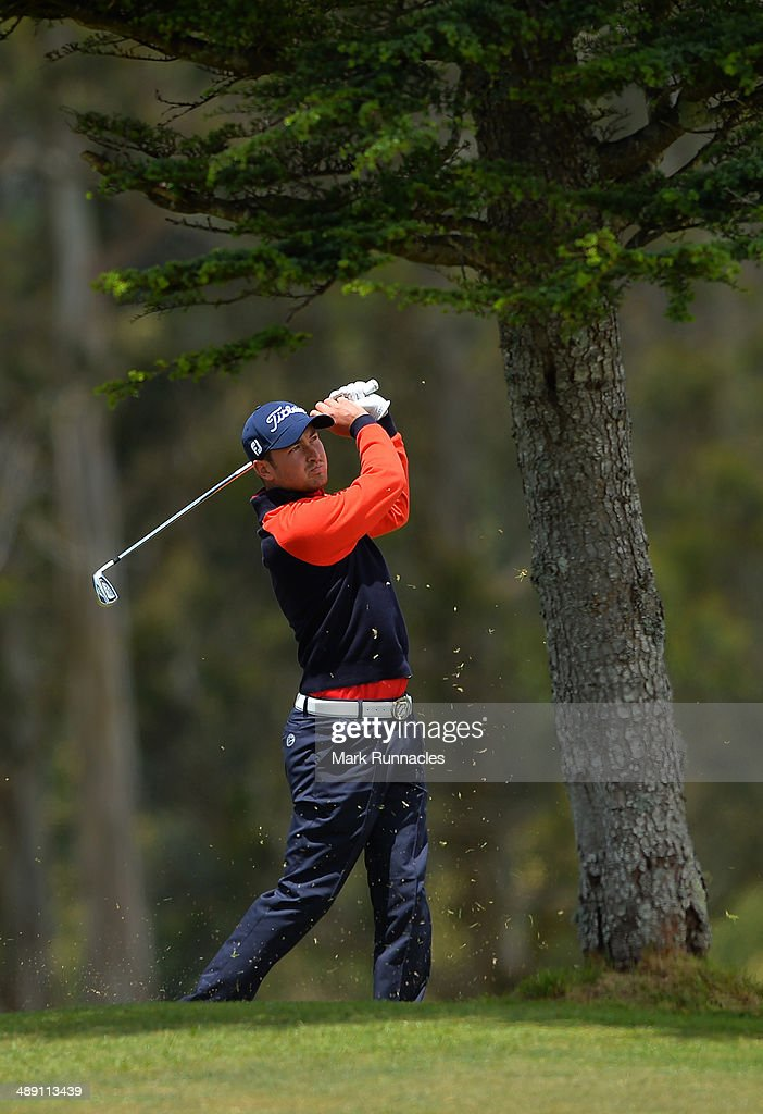 Daniel Brooks of England watches on after playing his approach shot to the 3rd green from behind a tree during the Madeira Islands Open - Portugal - BPI at Club de Golf do Santo da Serra on May 10, 2014 in Funchal, Madeira, Port gal.