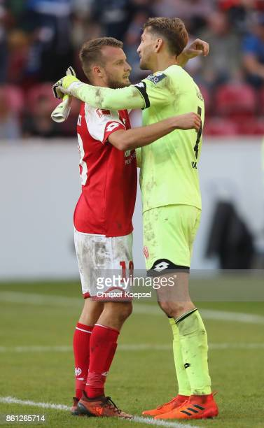 Daniel Brosinski and Rene Adler of Mainz embrace each other after the Bundesliga match between 1 FSV Mainz 05 and Hamburger SV at Opel Arena on...