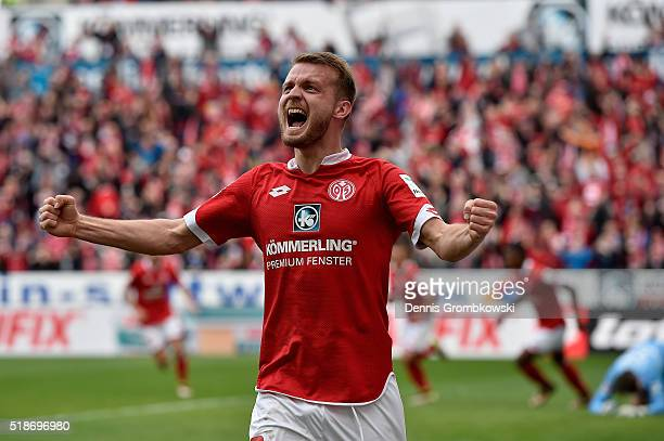 Daniel Brosinski celebrates as team mate Pablo De Blasis of 1 FSV Mainz 05 scores their third goal during the Bundesliga match between 1 FSV Mainz 05...