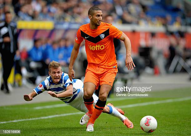 Daniel Brosinski of Duisburg and Mounir Chaftar of Bochum battle for the ball during the Second Bundesliga match between MSV Duisburg and VfL Bochum...