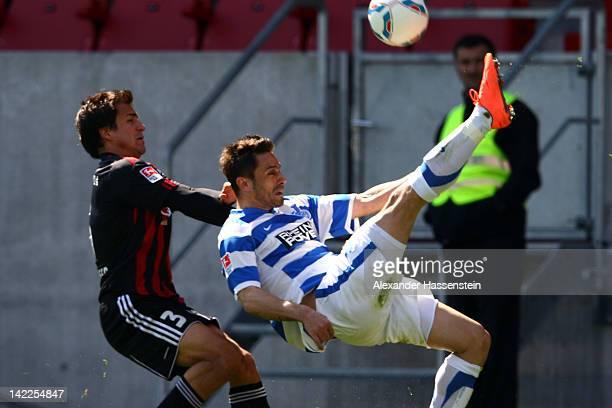 Daniel Brosinski of Duisburg battles for the ball with Andreas Schaefer of Ingolstadt during the Second Bundesliga match between FC Ingolstadt and...