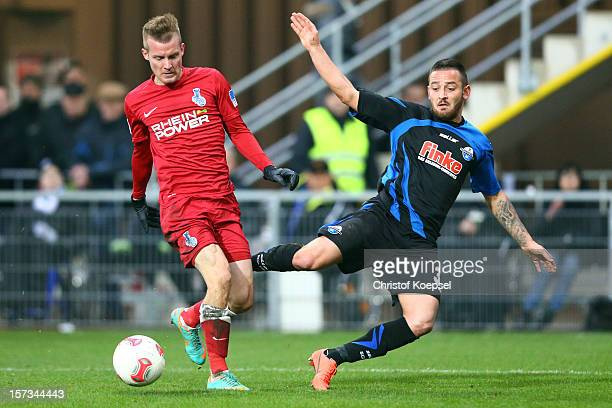 Daniel Brosinski of Duisburg challenges Deniz Naki of Paderborn during the Second Bundesliga match between SC Paderborn and MSV Duisburg at the...