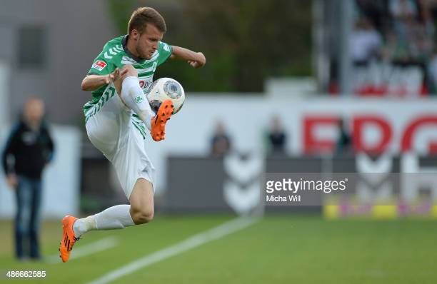 Daniel Brosinski of Fuerth jumps for the ball during the Second Bundesliga match between Greuther Fuerth and 1860 Muenchen at TrolliArena on April 25...