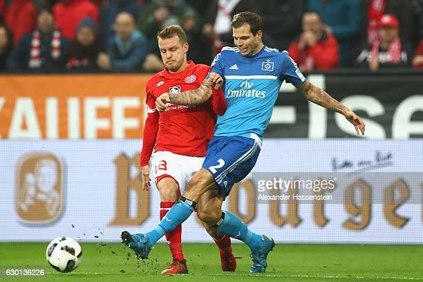 Daniel Brosinski of Mainz battles for the ball with Dennis Diekmeier of Hamburg during the Bundesliga match between 1 FSV Mainz 05 and Hamburger SV...