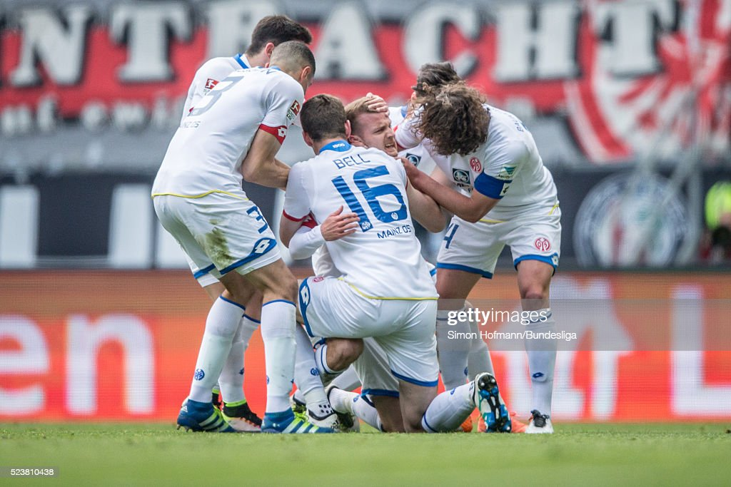 <a gi-track='captionPersonalityLinkClicked' href=/galleries/search?phrase=Daniel+Brosinski&family=editorial&specificpeople=654244 ng-click='$event.stopPropagation()'>Daniel Brosinski</a> of Mainz celebrates his team's first goal with his team mates <a gi-track='captionPersonalityLinkClicked' href=/galleries/search?phrase=Leon+Balogun&family=editorial&specificpeople=5443646 ng-click='$event.stopPropagation()'>Leon Balogun</a> (L), <a gi-track='captionPersonalityLinkClicked' href=/galleries/search?phrase=Julian+Baumgartlinger&family=editorial&specificpeople=4228877 ng-click='$event.stopPropagation()'>Julian Baumgartlinger</a> (R) and Stefan Bell (C) during the Bundesliga match between Eintracht Frankfurt and 1. FSV Mainz 05 at Commerzbank-Arena on April 24, 2016 in Frankfurt am Main, Germany.