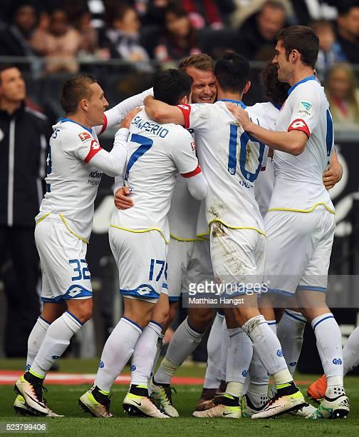 Daniel Brosinski of Mainz celebrates his team's first goal with team mates during the Bundesliga match between Eintracht Frankfurt and 1 FSV Mainz 05...