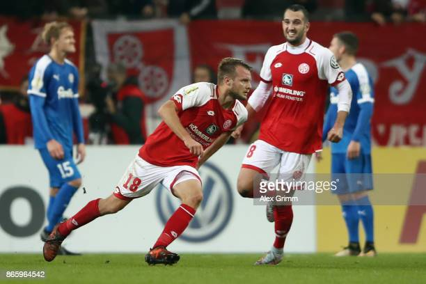 Daniel Brosinski of Mainz celebrates his team's third goal during the DFB Cup match between 1 FSV Mainz 05 and Holstein Kiel at Opel Arena on October...