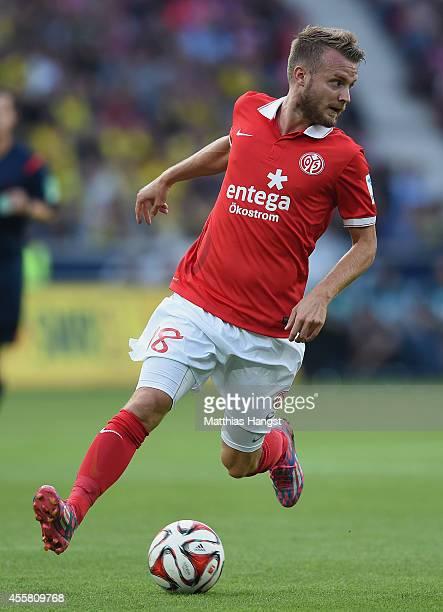 Daniel Brosinski of Mainz controls the ball during the Bundesliga match between 1 FSV Mainz 05 and Borussia Dortmund at Coface Arena on September 20...