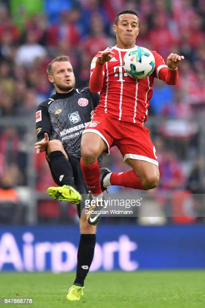 Daniel Brosinski of Mainz fights for the ball with Thiago Alcantara of Bayern Muenchen during the Bundesliga match between FC Bayern Muenchen and 1...