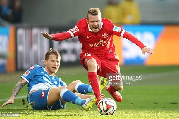 Daniel Brosinski of Mainz is challenged by Eugen Polanski of Hoffenheim during the Bundesliga match between 1899 Hoffenheim and 1 FSV Mainz 05 at...
