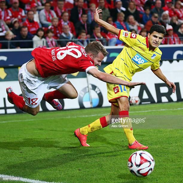Daniel Brosinski of Mainz is challenged by Tarik Elyounoussi of Hoffenheim during the Bundesliga match between 1 FSV Mainz 05 and 1899 Hoffenheim at...