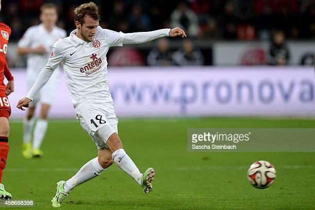 Daniel Brosinski of Mainz plays the ball during the Bundesliga match between Bayer 04 Leverkusen and 1 FSV Mainz 05 at BayArena on November 8 2014 in...