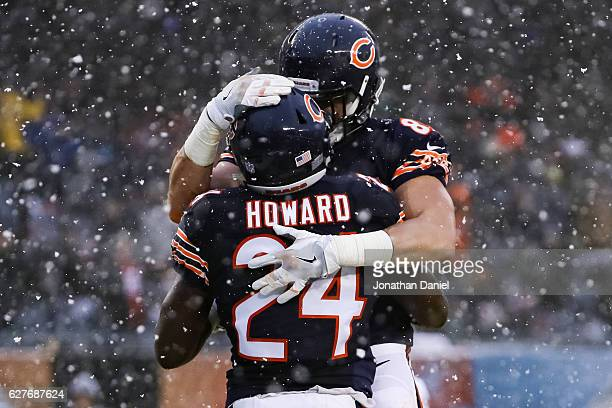 Daniel Brown and Jordan Howard of the Chicago Bears celebrate after Howard scored in the third quarter against the San Francisco 49ers at Soldier...