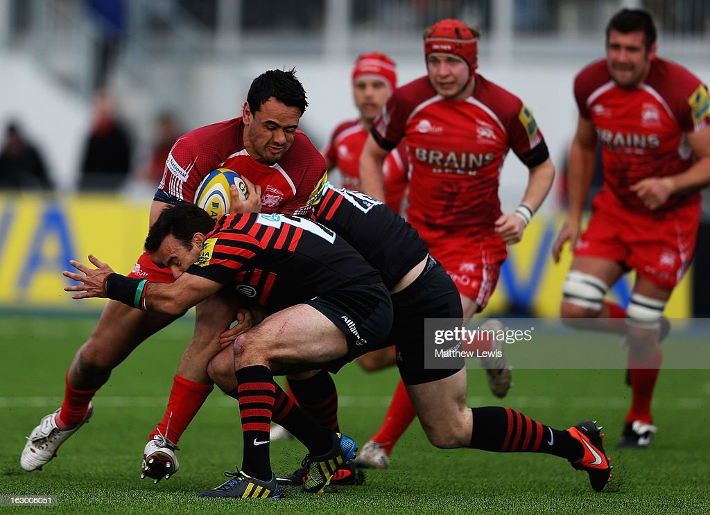 Daniel Browne of London Welsh is caught by the Saracens defence during the Aviva Premiership match between Saracens and London Welsh at Allianz Park on March 3, 2013 in Barnet, England.