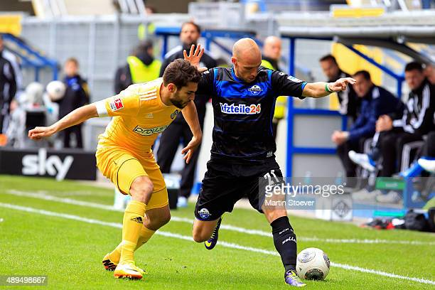 Daniel Brueckner of Paderborn challenges Nejmeddin Daghfous of Aalen during the match between SC Paderborn and VFR Aalen at Benteler Arena on May 11...