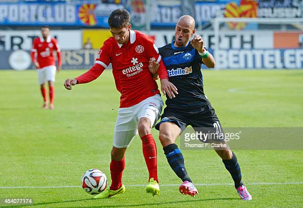 Daniel Brueckner of Paderborn tackles Christoph Moritz of Mainz during the Bundesliga match between SC Paderborn and FSV Mainz 05 at Benteler Arena...
