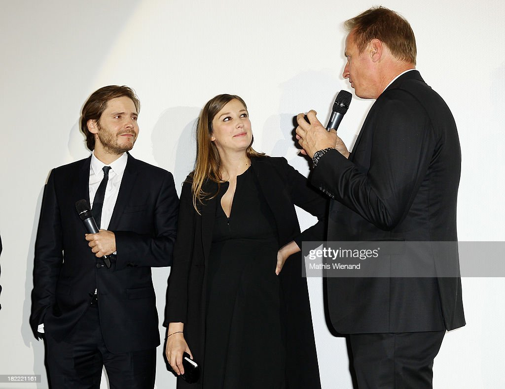 Daniel Bruehl, <a gi-track='captionPersonalityLinkClicked' href=/galleries/search?phrase=Alexandra+Maria+Lara&family=editorial&specificpeople=208220 ng-click='$event.stopPropagation()'>Alexandra Maria Lara</a> and Florian Koenigattend the German premiere of the film 'Rush' at Cinedom on September 28, 2013 in Cologne, Germany.