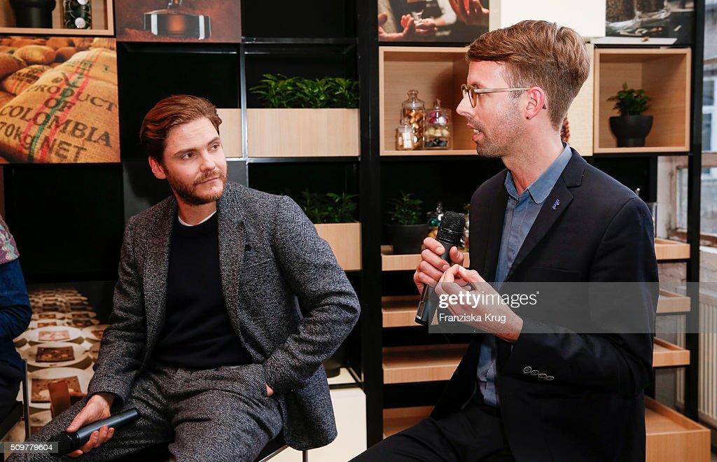 Daniel Bruehl and Florian Weghorn attend the Nespresso 'Auf einen Kaffee mit...' on February 12, 2016 in Berlin, Germany.