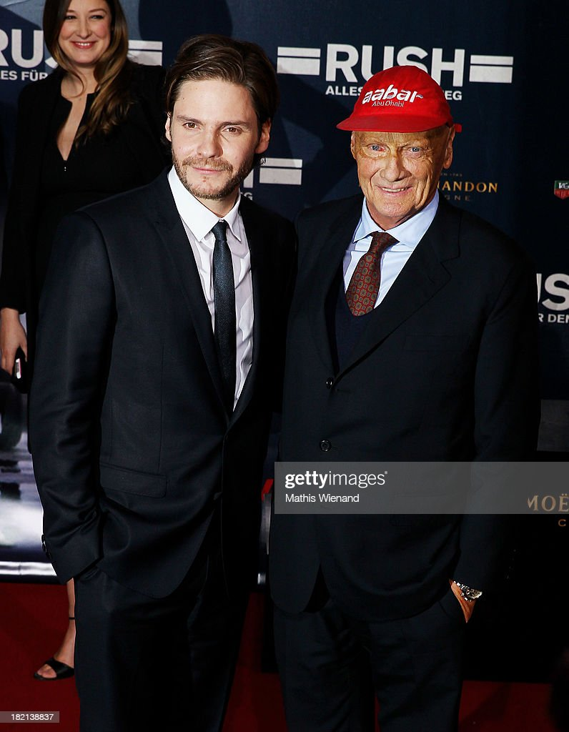 Daniel Bruehl and <a gi-track='captionPersonalityLinkClicked' href=/galleries/search?phrase=Niki+Lauda&family=editorial&specificpeople=218060 ng-click='$event.stopPropagation()'>Niki Lauda</a> attend the German premiere of the film 'Rush' at Cinedom on September 28, 2013 in Cologne, Germany.