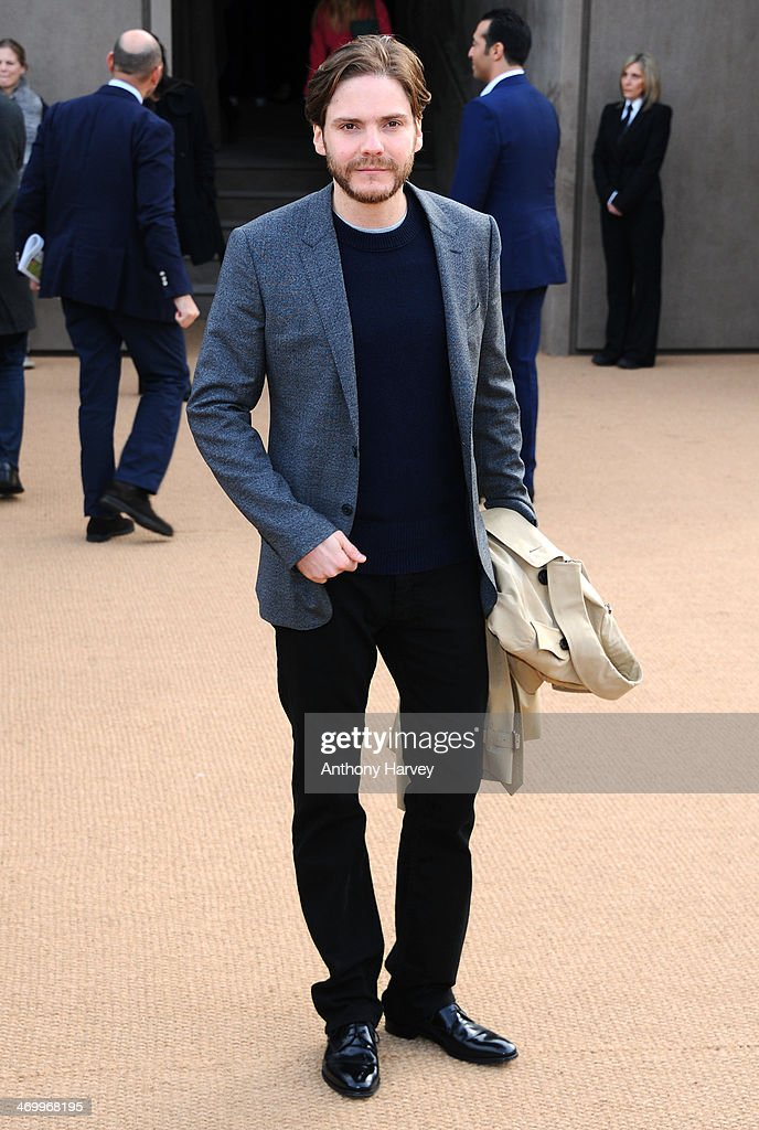 Daniel Bruehl attends the Burberry Prorsum show at London Fashion Week AW14 at Kensington Gardens on February 17, 2014 in London, England.
