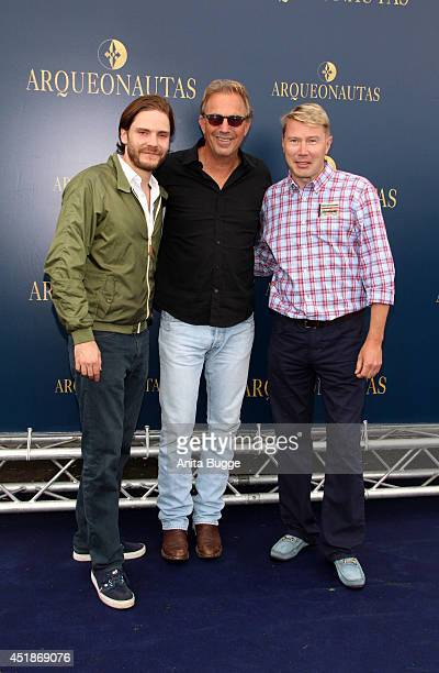 Daniel Bruehl Kevin Costner and Mika Haekkinen attend the 'Arqueonautas Presents Kevin Coster Music Meets Fashion' at Spindler Klatt on July 8 2014...