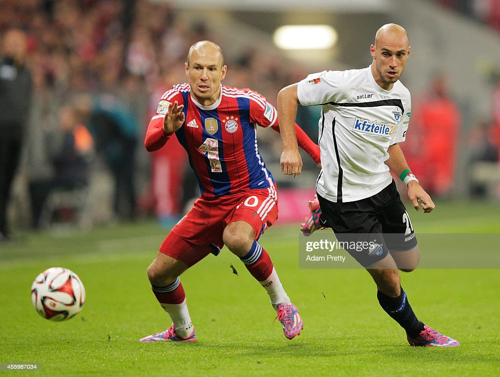 Daniel Bruekner of Paderborn is challenged Arjen Robben of Muenchen during the Bundesliga match between FC Bayern Muenchen and SC Paderborn 07 at...