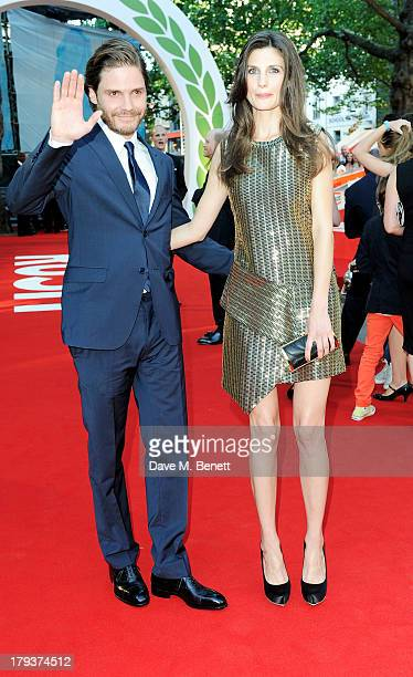 Daniel Bruhl and Felicitas Rombold attend the World Premiere of 'Rush' at Odeon Leicester Square on September 2 2013 in London England