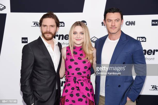 Daniel Bruhl Dakota Fanning and Luke Evans attend the Turner Upfront 2017 arrivals on the red carpet at The Theater at Madison Square Garden on May...