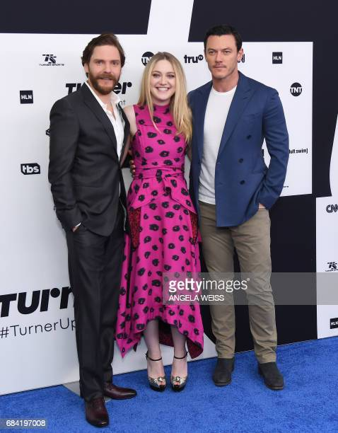 Daniel Bruhl Dakota Fanning and Luke Evans attend the Turner Upfront 2017 at The Theater at Madison Square Garden on May 17 2017 in New York City /...