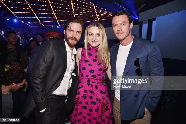 Daniel Bruhl Dakota Fanning and Luke Evans pose during the Turner Upfront 2017 show at The Theater at Madison Square Garden on May 17 2017 in New...