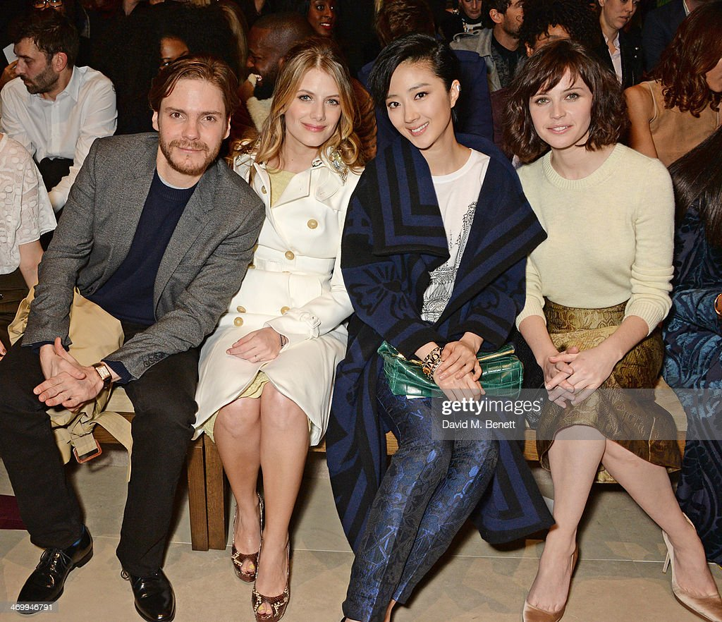 Daniel Bruhl, <a gi-track='captionPersonalityLinkClicked' href=/galleries/search?phrase=Melanie+Laurent&family=editorial&specificpeople=2721978 ng-click='$event.stopPropagation()'>Melanie Laurent</a>, Guey Lun-Mei and <a gi-track='captionPersonalityLinkClicked' href=/galleries/search?phrase=Felicity+Jones&family=editorial&specificpeople=5128418 ng-click='$event.stopPropagation()'>Felicity Jones</a> attend the front row at Burberry Womenswear Autumn/Winter 2014 at Kensington Gardens on February 17, 2014 in London, England.