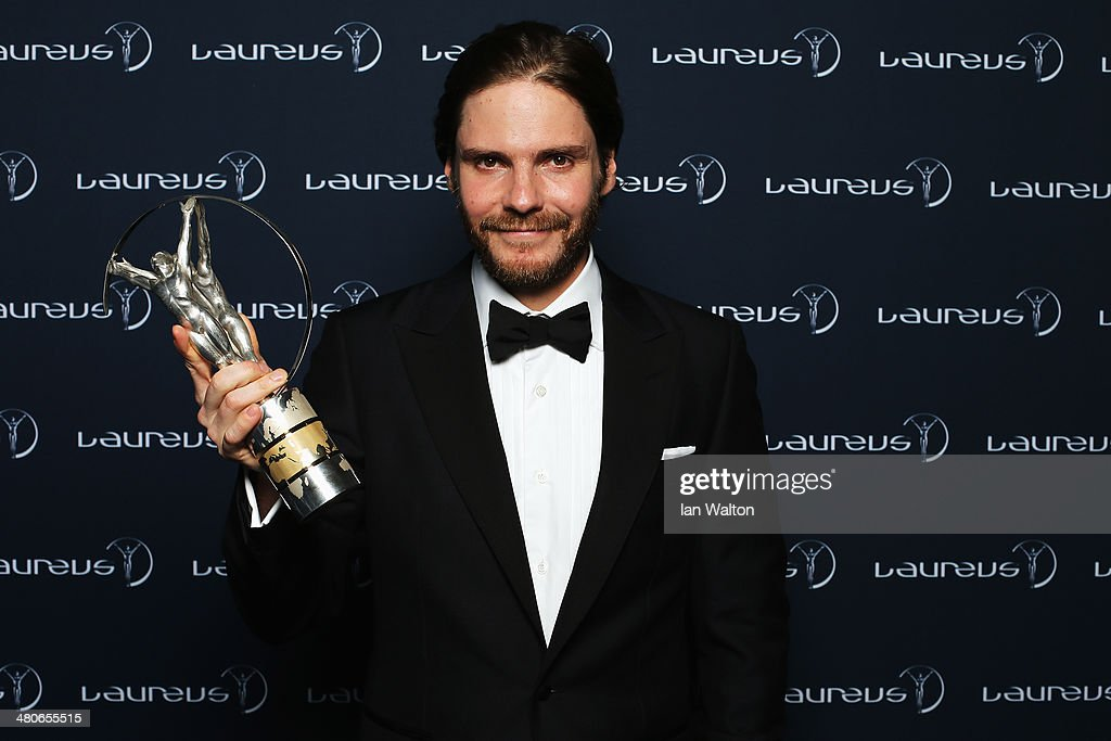 Daniel Bruhl poses with the Laureus trophy during the 2014 Laureus World Sports Awards at the Istana Budaya Theatre on March 26, 2014 in Kuala Lumpur, Malaysia.