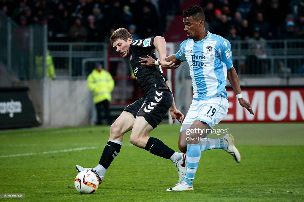 Daniel Buballa (L) of Hamburg and Rubin Rafael Okotie (R) of Muenchen compete for the ball during the Second Bundesliga match between FC St. Pauli and 1860 Muenchen at Millerntor Stadium on April 29, 2016 in Hamburg, Germany.