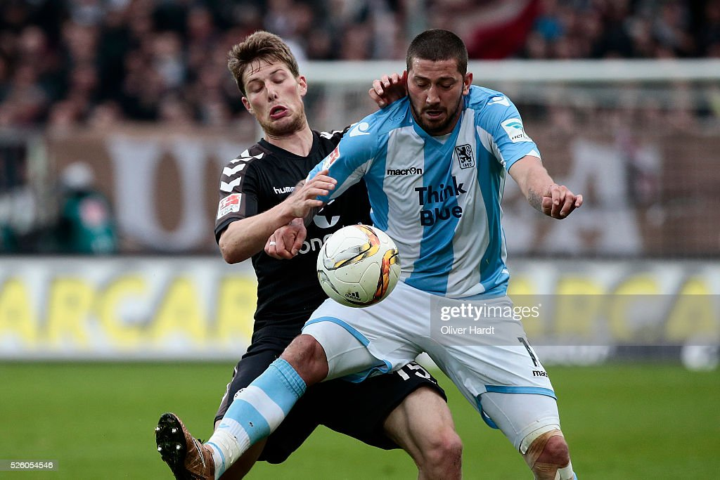 Daniel Buballa (L) of Hamburg and Sascha Moelders (R) of Muenchen compete for the ball during the Second Bundesliga match between FC St. Pauli and 1860 Muenchen at Millerntor Stadium on April 29, 2016 in Hamburg, Germany.
