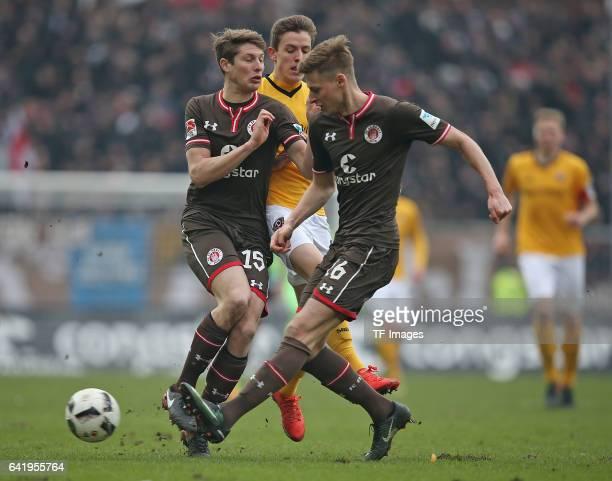 Daniel Buballa of St Pauli and Niklas Hauptmann of Dynamo Dresden Marc Hornschuh of St Pauli battle for the ball during the Second Bundesliga match...