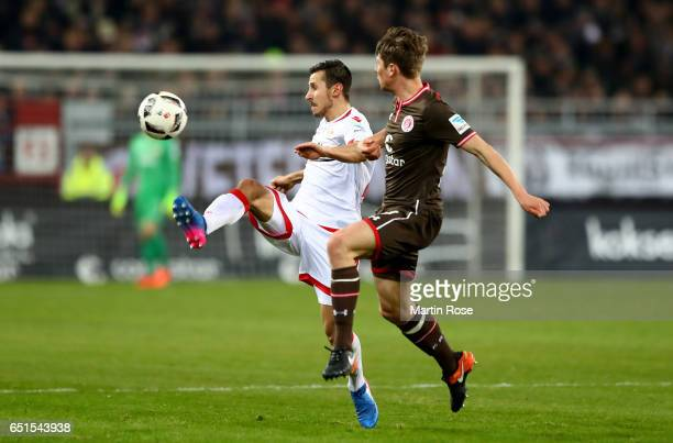 Daniel Buballa of St Pauli and Steven Skrzybski of Union Berlin battle for the ball during the Second Bundesliga match between FC St Pauli and 1 FC...