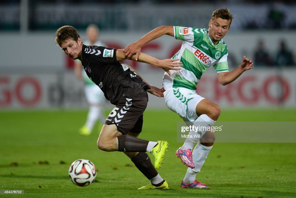 Daniel Buballa (L) of St.Pauli and Tom Weilandt of Fuerth compete for the ball during the Second Bundesliga match between Greuther Fuerth and FC St. Pauli at Trolli-Arena on September 1, 2014 in Fuerth, Germany.