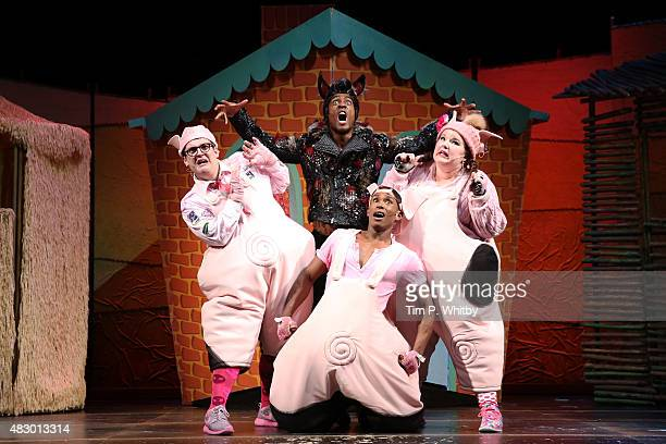 Daniel Buckley Simon Webbe Taofique Folarin and Leanne Jones perform on stage during a photocall for 'The Three Little Pigs' at Palace Theatre on...