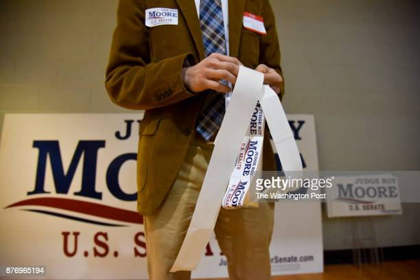 Daniel Burns hands out Roy Moore campaign material at the Madison County Republican Mens Club monthly breakfast at Trinity United Methodist Church on...