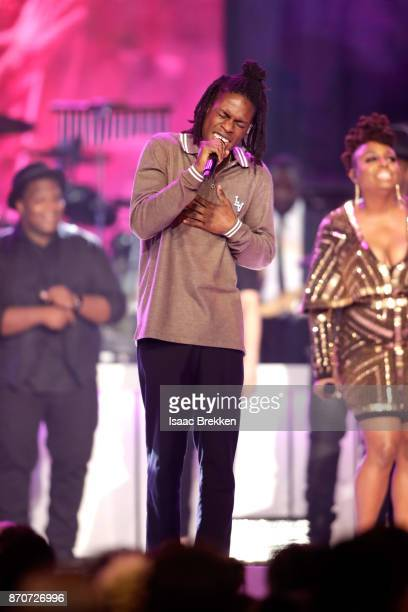Daniel Caesar and Ledisi perform onstage at the 2017 Soul Train Awards presented by BET at the Orleans Arena on November 5 2017 in Las Vegas Nevada