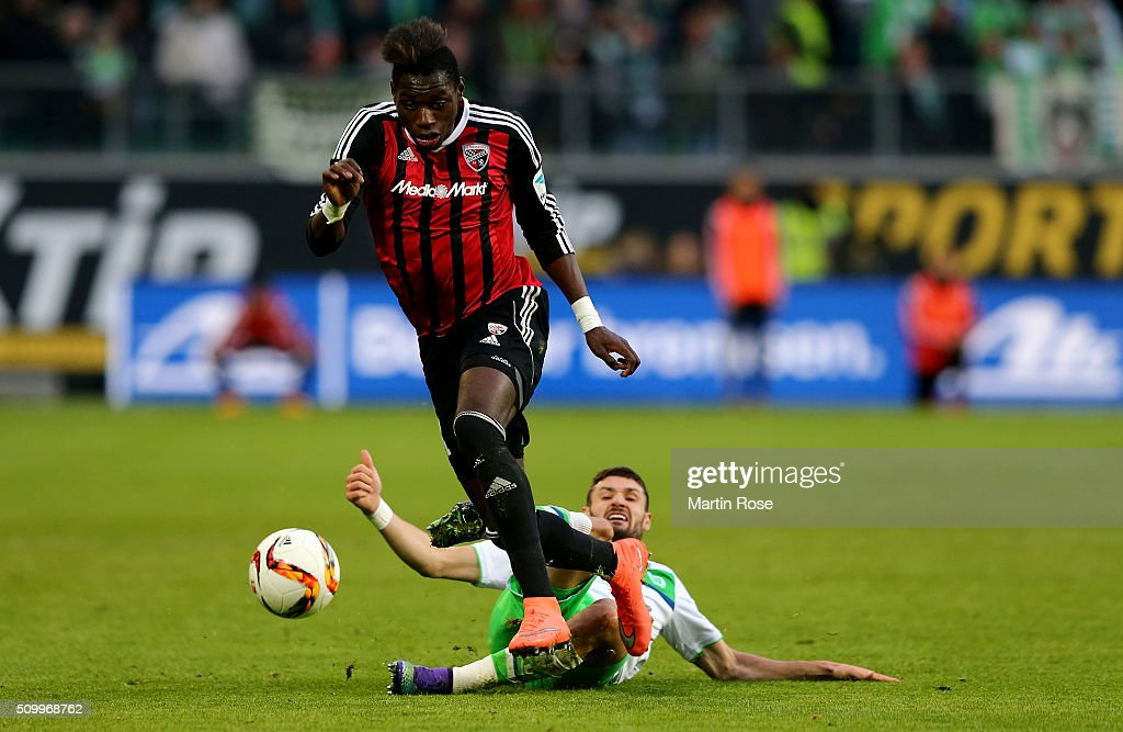 Daniel Caligiur #7 of Wolfsburg and Danny da Costa #21 of Ingolstadt battle for the ball during the Bundesliga match between VfL Wolfsburg and FC Ingolstadt at Volkswagen Arena on February 13, 2016 in Wolfsburg, Germany.
