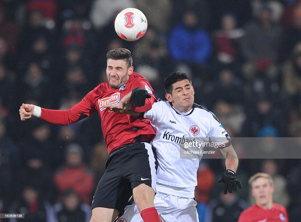 Daniel Caligiuri of Freiburg (L) challenges Carlos Zambrano of Eintracht Frankfurt during the Bundesliga match between SC Freiburg and Eintracht Frankfurt at MAGE SOLAR Stadium on February 22, 2013 in Freiburg, Germany.
