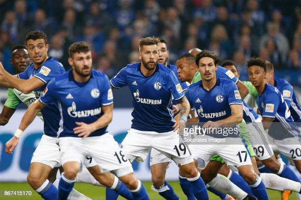 Daniel Caligiuri of Schalke 04 Guido Burgstaller of Schalke 04 Benjamin Stambouli of Schalke 04 awaiting a corner during the German Bundesliga match...