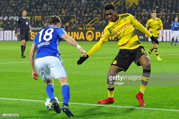 Daniel Caligiuri of Schalke and DanAxel Zagadou of Dortmund battle for the ball during the Bundesliga match between Borussia Dortmund and FC Schalke...